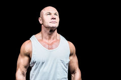 Bodybuilder in vest looking up Royalty Free Stock Image