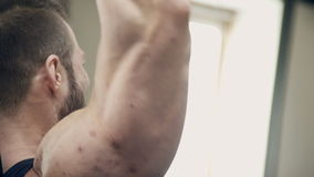 Bodybuilder in the weight belt lifting heavy dumbbells hands. stock video footage