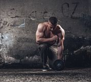 Bodybuilder with weight royalty free stock photography