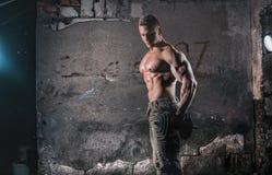 Bodybuilder with weight stock photo