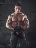Bodybuilder with weight royalty free stock images