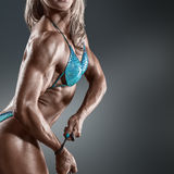 Bodybuilder woman in bikini Stock Images