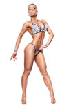 Bodybuilder woman in blue bikini Royalty Free Stock Photo