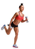Bodybuilder woman with dumbbells full length Stock Photography