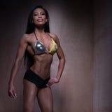 Bodybuilder Woman Posing in Fitness Bikini stock images
