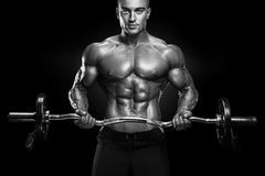 Bodybuilder workout with barbell Royalty Free Stock Images