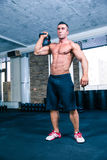 Bodybuilder workout with kettle ball in crossfit gym Royalty Free Stock Image