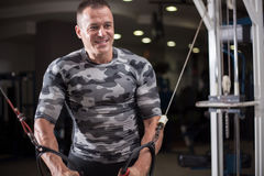 Bodybuilder works out pushing up excercise in gym Royalty Free Stock Images