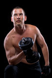 Bodybuilder z dumbbell, strzał na czerni Obrazy Royalty Free