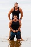 Bodybuilders on the beach Stock Photo