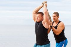 Bodybuilders on the beach Royalty Free Stock Images