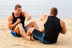 Bodybuilders on the beach Stock Image