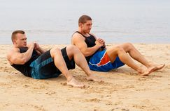 Bodybuilders on the beach Stock Photography