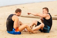 Bodybuilders on the beach Royalty Free Stock Photos