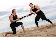 Bodybuilders on the beach Stock Photo