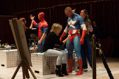 Bodybuilders during a body painting session at Milano Tattoo Convention Royalty Free Stock Photography
