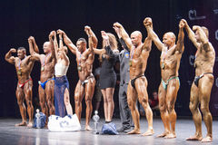 Bodybuilders celebrate their victory showing their medals Royalty Free Stock Photo