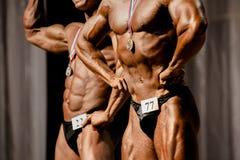 bodybuilders d'athlètes d'hommes image libre de droits