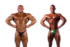 Bodybuilders flexing Royalty Free Stock Photos