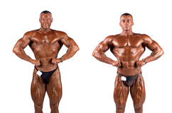 Bodybuilders flexing Royalty Free Stock Images