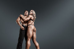 Bodybuilders muscular man and woman Royalty Free Stock Image