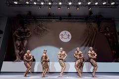 Bodybuilders posing on stage. Stock Photo