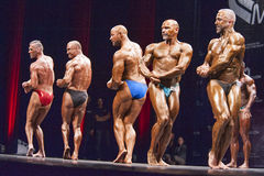 Bodybuilders show their best chest pose in a lineup comparison Stock Photography