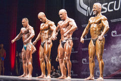 Bodybuilders show their front pose in a lineup comparison Royalty Free Stock Photos