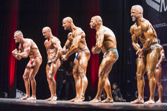 Bodybuilders show their most muscular pose in lineup comparison Stock Photography