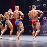 Bodybuilders show their physique on stage in championship Royalty Free Stock Photos