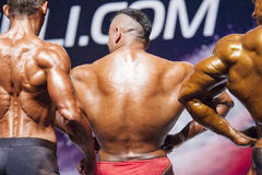 Bodybuilders show their physique on stage in championship Royalty Free Stock Images