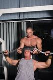 Bodybuilders training. Two Bodybuilders training in the gym Royalty Free Stock Photography