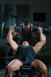 Bodybuilders training in gym Stock Images