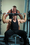 Bodybuilders training in gym Royalty Free Stock Images