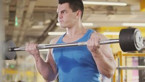 Bodybuilding athlet in the gym - muscular man perform exercises with barbell biceps, close up. Close up view royalty free stock images