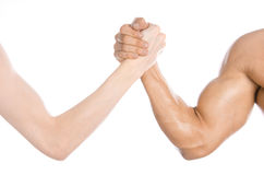 Bodybuilding & Fitness Topic: arm wrestling thin hand and a big strong arm isolated on white background in studio Stock Images