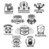Bodybuilding gym or powerlifting club vector icons. Gym and ironman bodybuilding or fitness club or workout sport center icons templates set. Vector badges of Stock Photo