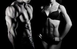 Bodybuilding. Man en vrouw Stock Afbeeldingen