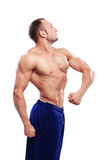 Bodybuilding. Man and his powerful body Royalty Free Stock Image