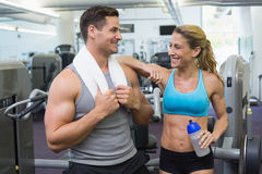 Bodybuilding man and woman chatting together Royalty Free Stock Image