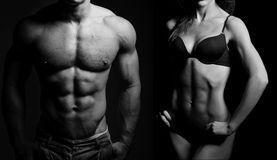 Bodybuilding. Man and  woman. Bodybuilding. Strong men and a women posing on a black background Royalty Free Stock Photography