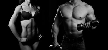 Bodybuilding. Man and  woman. Bodybuilding. Strong men and a women posing on a black background Royalty Free Stock Images