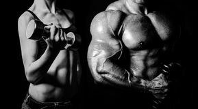 Bodybuilding. Man and  woman. Bodybuilding. Strong men and a women posing on a black background Royalty Free Stock Photos