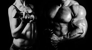 Bodybuilding. Man and woman. Bodybuilding. Strong men and a women posing on a black background royalty free stock photo