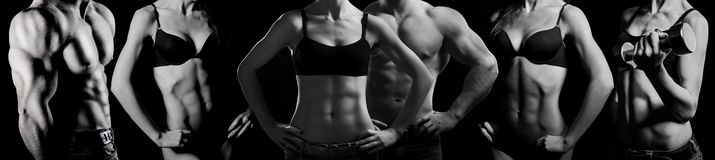 Bodybuilding. Man and  woman. Bodybuilding. Strong man and a woman posing on a black background Stock Photo