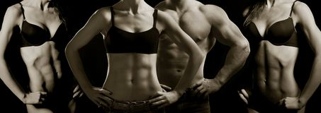 Bodybuilding. Man and  woman. Bodybuilding. Strong man and a woman posing on a black background Stock Photography