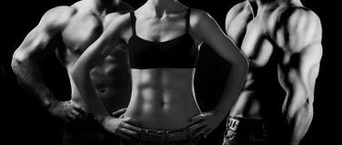Bodybuilding. Mężczyzna i kobieta Zdjęcia Royalty Free