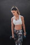 Bodybuilding model exercising with heavy dumbbells stock image