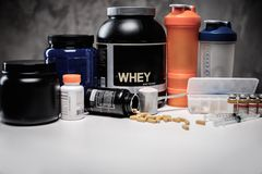 Bodybuilding nutrition. Supplements and chemistry Stock Images