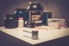 Bodybuilding nutrition. Supplements and chemistry Stock Image